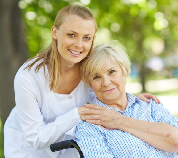 caregiver with woman in wheelchair